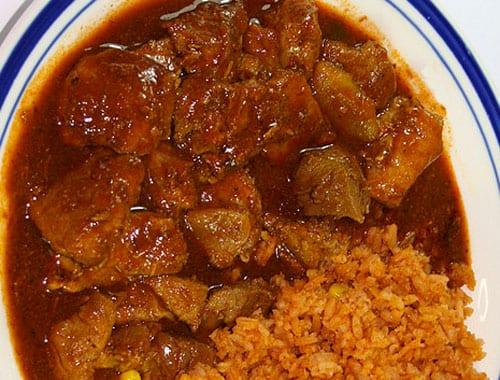 Carne de puerco en chile colorado y verdolagas | Recetas Mexicanas