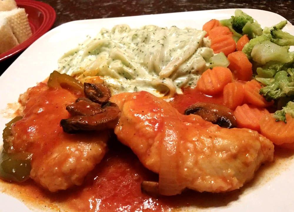 pollo en puré de tomate